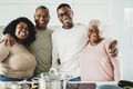 Happy black family cooking inside kitchen at home - Main focus on father face - PhotoDune Item for Sale
