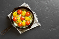 Fried eggs with tomatoes in frying pan - PhotoDune Item for Sale