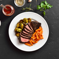 Grilled beef steak with brussels sprouts and sweet potatoes - PhotoDune Item for Sale