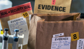 Files and evidence bag in a crime lab, conceptual image - PhotoDune Item for Sale