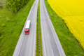 Aerial view of a truck on the highway at sunset. Shipping and delivery - PhotoDune Item for Sale