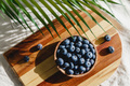 Fresh blueberry in a wooden bowl on a linen light cloth. Healthy eating and Summer concept. - PhotoDune Item for Sale