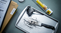 Fingerprint development on a knife involved in a homicide in a crime lab, conceptual image - PhotoDune Item for Sale