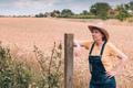 Female farmer posing in ripe barley field just before the harvest - PhotoDune Item for Sale