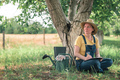 Female farmer writing notes in walnut orchard - PhotoDune Item for Sale