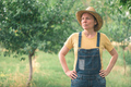 Portrait of female farmer posing in plum fruit orchard - PhotoDune Item for Sale