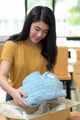 Woman packs shirts into boxes for shipping, Online shopping, Parcel delivery. - PhotoDune Item for Sale