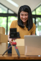 A young woman is live through the camera to sell products online, Selling products online. - PhotoDune Item for Sale