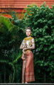 Charming Thai woman in Beautiful traditional dress at archaeological site - PhotoDune Item for Sale