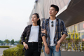 Happy Young couple standing out of shopping mall - PhotoDune Item for Sale
