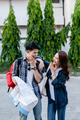 Cheerfully Young backpacker couple smile while travel on street town - PhotoDune Item for Sale
