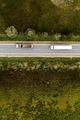 Two large transporter semi-trucks on the road, aerial view - PhotoDune Item for Sale