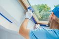 Preparing Room Window Edges For Painting Job - PhotoDune Item for Sale