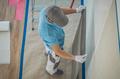 Caucasian Worker Applying Vinyl Wallpaper - PhotoDune Item for Sale