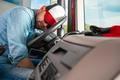 Semi Truck Driver Sleeping on the Steering Wheel - PhotoDune Item for Sale