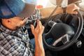 Caucasian Trucker Providing Conversation Using CB Radio Inside His Truck - PhotoDune Item for Sale