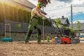 Gardener with Gasoline Engine Aerator - PhotoDune Item for Sale