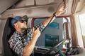 Caucasian Semi Truck Driver Talking by CB Radio - PhotoDune Item for Sale