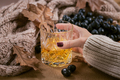 Whiskey, brandy or liquor, spices and decorations on dark background - PhotoDune Item for Sale