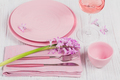 Pink rustic table setting with purple hyacinth flowers, linen napkin and glass of rose wine - PhotoDune Item for Sale