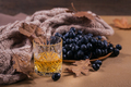 A glass of whiskey or bourbon, spices and decoration on dark background - PhotoDune Item for Sale