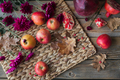 Harvest of red apples, grapefruit with autumn leaves and flowers on a wooden table - PhotoDune Item for Sale