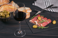 Glass of red wine with slices of cured ham - PhotoDune Item for Sale