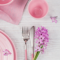 Pink rustic place setting with purple hyacinth flower and linen napkin on white wooden background - PhotoDune Item for Sale