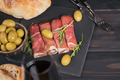 Black stone platter with slices of cured ham - PhotoDune Item for Sale