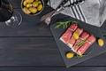 Black stone platter with slices of cured ham or Spanish jamon serrano or Italian prosciutto crudo - PhotoDune Item for Sale