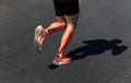 male runner legs on calf kinesio taping - PhotoDune Item for Sale
