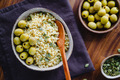 Bulgur with green olives and pepitas, healthy nutrition easy recipe from long-stored food. - PhotoDune Item for Sale