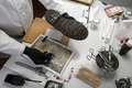 Forensic scientist investigates shoeprint mould evidence in crime lab, conceptual image - PhotoDune Item for Sale