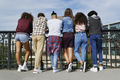 Rear view of people standing in front of the railing - PhotoDune Item for Sale