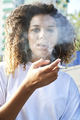 Portrait of young woman smoking cigarette - PhotoDune Item for Sale