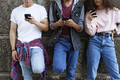 Front view of unrecognizable young people standing with mobile phones - PhotoDune Item for Sale