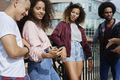 Group of friends standing together with mobile phone - PhotoDune Item for Sale