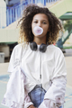 Young woman blowing bubble gum - PhotoDune Item for Sale