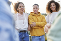 Group of young friends standing and talking outdoors - PhotoDune Item for Sale