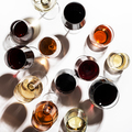 Red, rose and white wine in glasses on white background, top view - PhotoDune Item for Sale