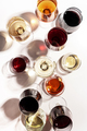 Red, rose and white wine in glasses on white background, top view. - PhotoDune Item for Sale