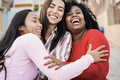 Happy latin friends having fun together outdoor around city - Main focus on black woman face - PhotoDune Item for Sale