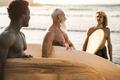 Multi generational surfer men having fun on the beach - Main focus on african man - PhotoDune Item for Sale
