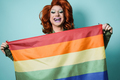 Portrait of drag queen holding rainbow flag - Lgbt concept - Focus on face - PhotoDune Item for Sale