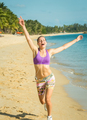 Fitness sport woman running on beach outside at sunset. - PhotoDune Item for Sale
