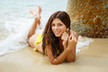 Relaxing beach woman enjoying the sea in swimsuit. Glamorous girl with gold tattoo on the hand. - PhotoDune Item for Sale