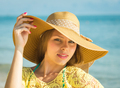 Happy woman enjoying beach relaxing joyful in summer by tropical blue water. - PhotoDune Item for Sale