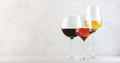 Wines assortment. Red, white, rose wine in wineglasses on gray background. Wine bar, shop, - PhotoDune Item for Sale