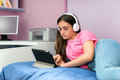 Young teenage girl relaxing watching media on a tablet pc - PhotoDune Item for Sale