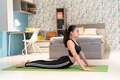 Fit athletic young girl working out at home doing yoga - PhotoDune Item for Sale